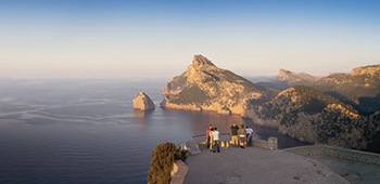 Travellers looking out over Majorca's Cap de Formentor, known as the meeting point of the winds