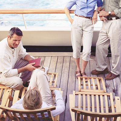 A group of people in chinos lounging on deck.