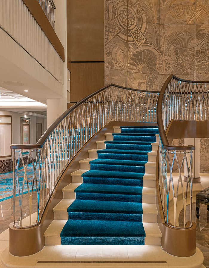 The lush teal carpet of the Atrium staircase