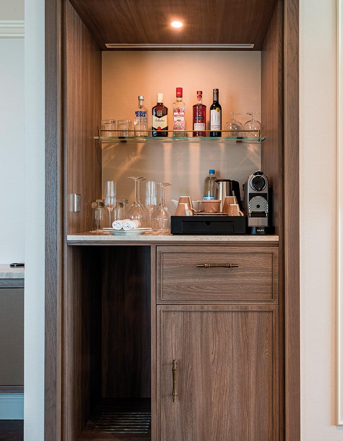 Enjoy a drink your your in-cabin bar