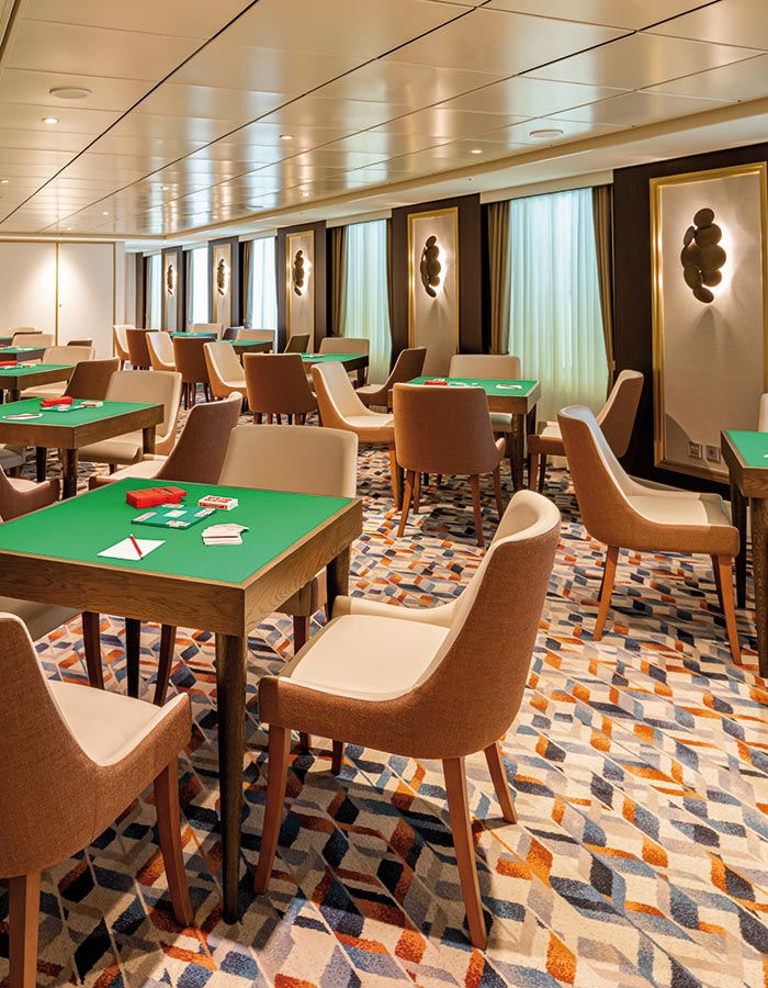 Enjoy a card game at sea