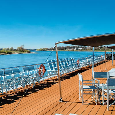 Relax and enjoy the scenery rolling by on deck from a lounger