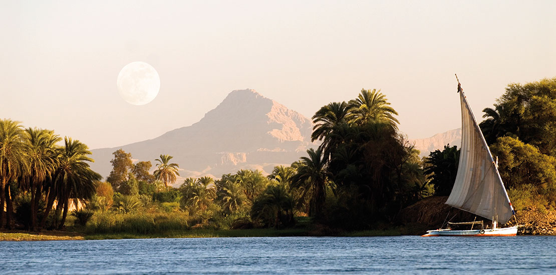 Watch Egyptian Felucca sail by at Luxor on the River Nile while you enjoy the classic scenery