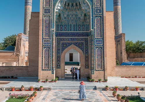 A woman walking towards Gur Emir Mausoleum in Samarkand, Uzbekistan