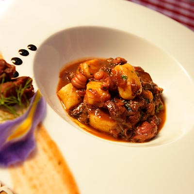 The traditional dish Pasticada, served with gnocchi