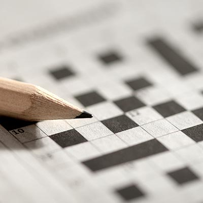 A crossword puzzle and pencil
